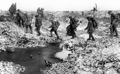 British soldiers negotiate a shell-cratered winter landscape along the Somme in late 1916 after the close of the Allied offensive.