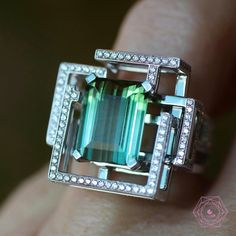 At @likeab. Look at this amazing green tourmaline setted in the new ring #labyrinth by @lorenzbaumer exquisite ring..