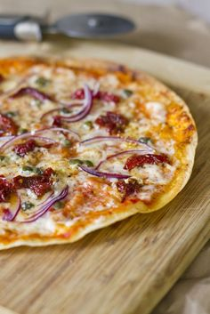 Mediterranean Tostada | 1 tortilla, ⅓ cup parmesan cheese, 1 tbs. tomato sauce, ½ tbs. olive oil, 1 tbs. sun-dried tomatoes, ½ tsp. capers, 1 clove garlic, ½ oz. red onion, sliced paper thin, salt and pepper