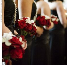 Deep Black  Magic and Charlotte roses made up the bulk of the bridesmaid bouquets.  The bigger blooms were accented by mini ivory roses, dendrobium orchids,  and scattered rhinestones.