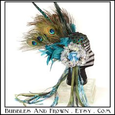 """""""Seaside Seductress"""" Feather Headband in blues with peacock adornments."""