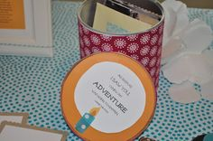 1st Birthday Time capsule: Party attendees write letters, words of wisdom, wishes, hopes, dreams. They insert photos, newspapers or articles, knick knacks, etc. To give to B on her 19th birthday. Was a hit at the party!! Supplies: cleaned baby formula can, fabric, mod podge, cardstock. Quote on side of lid: As soon as I saw you, I knew an adventure was going to happen. --Winnie the Pooh
