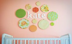 Wall art using wooden letters and swatch portraits