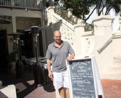 Kevin Neel, owner of La Crema poses in front of restaurant at Rosemary Beach, Florida go to http://americanroads.net/off_beaten_path_winter2014.htm for the rest of the story
