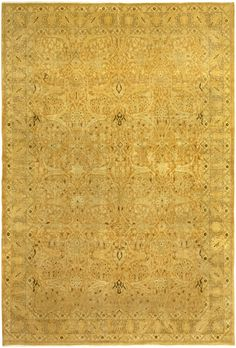 The uniqueness of this antique Persian Tabriz rug is perhaps immediately evident in its bold gold color, offset by floral designs, abstractions and arabesques in an exotic signature style of antique oriental rugs. Coming from the rich carpet-weaving tradition of the Iranian city of Tabriz, it is an elegant collector