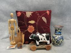 This prop set is from the television show Desperate Housewives.This is a Susan Meyer House Decor Collection.  These items can be seen in Susan's house through out production of the series.   This set includes:Glass Vase from Susan's Bedroom.   Throw Pillow from Susan's Family Room.   Decorative Cow from Susan's Art Nook.   Wooden Hand Bookend from Susan's Art Nook.   Model Figure from Susan's Art Nook which measures approximately 3 inches by 3 inches by 13 inches.