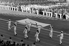 Tokyo Olympic Opening Ceremony TOKYO - OCTOBER 10: The Olympic flag is being carried during the opening ceremony of the Tokyo Olympic at the National Stadium on October 10, 1964 in Tokyo, Japan. (Photo by Sankei Archive via Getty Images)