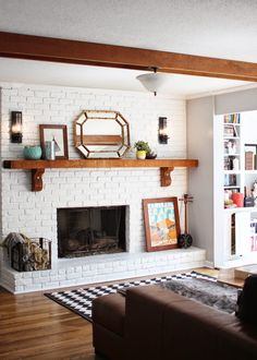 White brick fireplace. Exposed brick DIY. Love the beams and wooden accents!