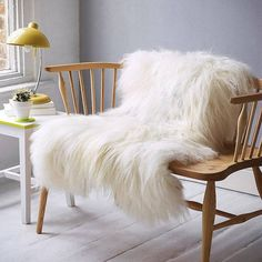 Sheepskin #rug really dresses the #wooden bench nicely for the year of the #sheep