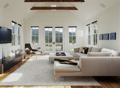white walls, dark beams, furniture-i like the clean lines and simplicity of this space...