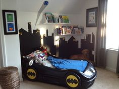 Super hero room :) love the painted car bed! I love the dog chillin in the back lol