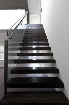 Modern Stairs // Dark Wood Stairs at the 5/6 House by Atelier rzlbd Photo