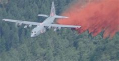 A Modular Airborne Fire Fighting System-equipped C-130 from the Air Force Reserve Command's 302nd Airlift Wing drops a load of a retardant in an effort to contain the Lime Gulch fire June 19 in southern Jefferson County, Colo. The 2013 MAFFS fire season began a week earlier when aircrews battled the Black Forest fire near Colorado Springs, Colo. (Courtesy photo)