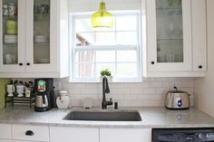 my cottagey ikea kitchen, home decor, kitchen design, kitchen island, shelving ideas, A coffee station to the left of the sink is used every morning The sink is a Blanco granite sink in Metallic Gray and the cute green light fixture is from Ballard Designs