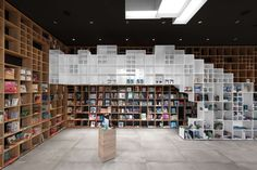 FIRM: SoNo Arhitekti PROJECT: Slovenian Book Center Trieste; LOCATION: Trieste, Italy. City book center that announces its purpose explicitly with bookcases made out of wood and glazed surfaces organizing and shaping much of the interior form.