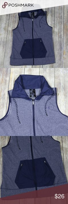 """Under Armour ColdGear Infrared Hybrid Zip Up Vest UA Under Armour Women's ColdGear Infrared Hybrid Zip Up Vest.  Size Medium.  Blue.  Style 1264109.  100% polyester.  Machine wash.  In good, preowned condition with no flaws noted. Measures approximately 19"""" pit to pit, 26"""" shoulder to hem. Stock photos show vest in a different color.  From online:  Fitted: Next-to-skin without the squeeze. Soft, textured microfleece traps heat for superior warmth ColdGear® Infrared lining uses a soft…"""