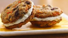Treat your family with these carrot sandwich cookies made using Pillsbury® Ready to Bake!™ oatmeal raisin cookies and filled with cream cheese-pineapple mixture - perfect for dessert.