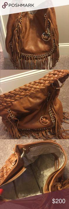 Michael Kors fringe handbag Brown leather handbag, braided strap, fringe detail on both sides, gold detail, pockets on the inside, only worn a few times, great condition Michael Kors Bags Shoulder Bags