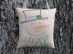 Primitive Snowman Door Hanger, Hand Embroidered Stitchery, Prim snowman decor, happy smiling snowman, Stocking Stuffer,  Lime Turquoise by WickedlyCreative on Etsy https://www.etsy.com/listing/255241835/primitive-snowman-door-hanger-hand