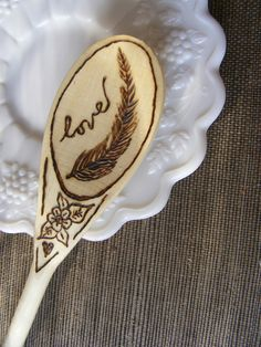 FEATHER / LOVE Wood Burned Spoon Woodburned Wooden Spoon. $12.00, via Etsy.