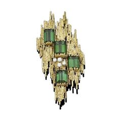 A gold, tourmaline and diamond brooch, by Andrew Grima,