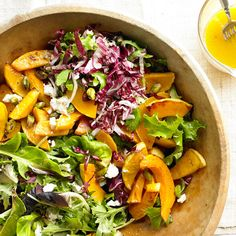 This delicious fall salad is topped with caramelized squash and goat cheese.