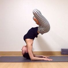 pincha mayurasana with padmasana  - this freaks me out everytime I see it.