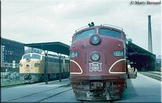 Rock Island boards passengers with the Twin Star Rocket at Minneapolis as Milwaukee Road is on point for today's Afternoon Hiawatha on June Pocono Mountains, Rocky Mountains, Rock Island Railroad, Train Posters, Islands In The Pacific, Railroad Pictures, Railroad History, Milwaukee Road, Railroad Photography