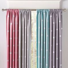 Make your child's room naptime-ready with these light-blocking drapes, available in several color options and with a fun polka dotted print. Set of two.