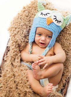 A baby is resting on a bed for a photoshoot. One Year Old Baby, Parents, Crochet Hats, Cap, Photoshoot, Kids, Blue, Photography, Fashion