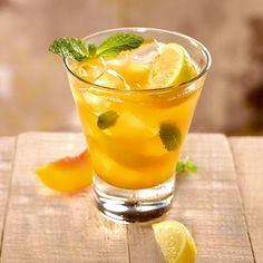 This cocktail features a delicious explosion of FIREBALL® Cinnamon Whisky, peach purée, lemon wedges and fresh mint, all mixed up with Red Robin's house-made sweet & sour mix.