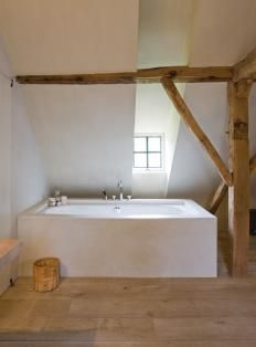 Old beams contrasting with clean white walls and modern bath