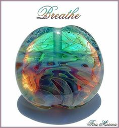 Breathe by Fira Marina, via Flickr Lentil shaped lampwork focal bead in teal, purple and amber.