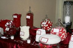Beautiful red and white wedding candy buffet.