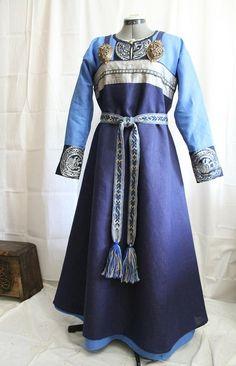 Norna's Mystery. Dark blue apron dress.