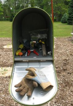 Mailbox in the garden for tool storage