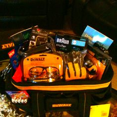 """tool birthday DeWalt themed bday for my boyfriend.  The tool bag was his """"gift basket"""" filled with all sorts of cool stuff.  -iPhone bottle opener case -work gloves -protective eyewear  -electric razor -couples fun workbooks -his favorite candy Alll sorts of things that he loves!! This was fun and easy to do!"""