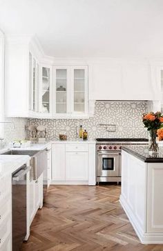 The vintage-looking floors combined with the shiny new white cabinets creates a contrast we can get behind.