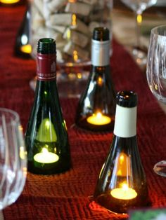 Wine Bottle Hurricanes A classy conversation starter, these carefully cut wine-bottle spouts impress guests and protect candle flames from evening breezes.