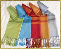 Pashminas are cheap and super warm. They also come in a million colors and therefore can make any outfit adorable.