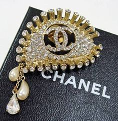 Chanel eye brooch