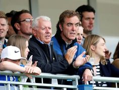 Gerry McIlroy, Rory's father, and actor James Nesbitt watch the first round. Photo: Reuters/Paul Childs