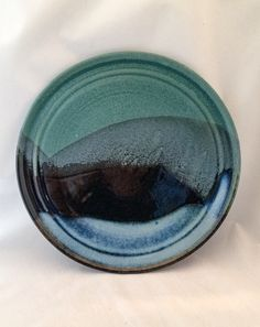 Large stoneware pottery plate/ platter- green, blue, and black glaze in a mountain landscape pattern by CenteredVessel on Etsy