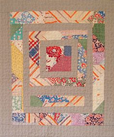 New improvised art quilt made of pieces from a worn vintage quilt and old ticking material.
