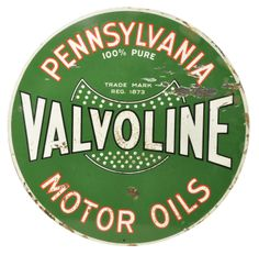 """Double sided porcelain curb sign for Valvoline Pennsylvania Motor Oils with deep green background and dotted shield graphic. Sign has chipping in field. Side 1 shows some staining. Side 2 has thick gunk buildup that looks like it would clean up as the other side shows signs of previously having the same, please judge photos carefully. size: 30"""" dia."""