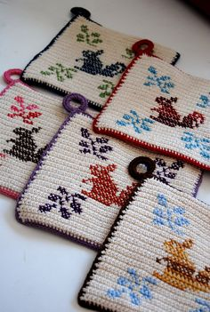 april 2, 2010 | Flickr - Photo Sharing! Crochet potholders with embroidery