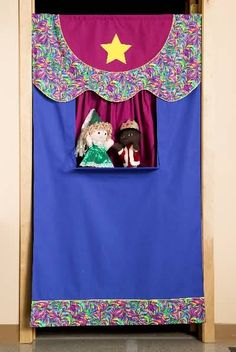Bring the theater home with you! Sewing pattern, doorway puppet theatre and puppets. $11.49