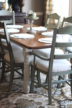 GORGEOUS chairs.  I was already planning natural linen seat covers for mine, and doing the top of the black table wood like this.  Maybe with blue chairs!