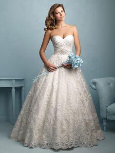 Pretty ballgown with sweetheart neckline and classic crystal detailing.  This one's gorgeous! From Allure Bridals.