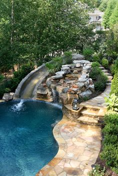 Backyard Pools With Slides swimming pool, slide, diving board, hot tub, and waterfall what